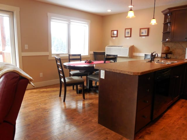 Dining table expands to seat 6, open to kitchen with French doors leading to BBQ deck & fresh mountain air...