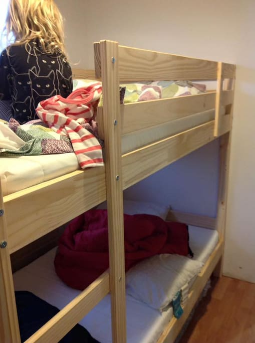 Bunk bed, extra mattress and couches for additional sleeping.