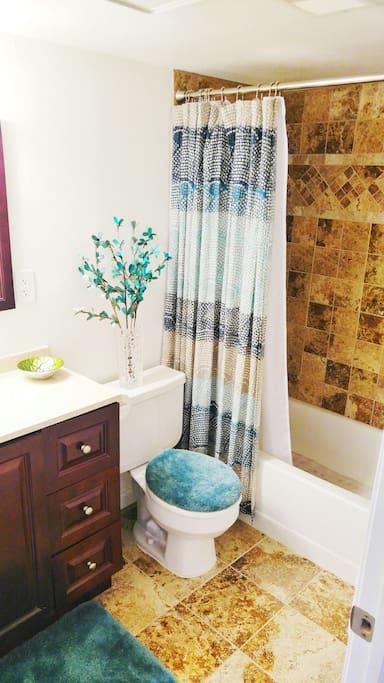 Beautiful full bathroom with clean granite shower