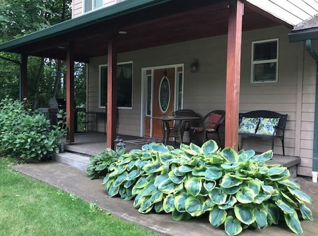 Shady front porch to enjoy the peace and quiet or to have your morning coffee.