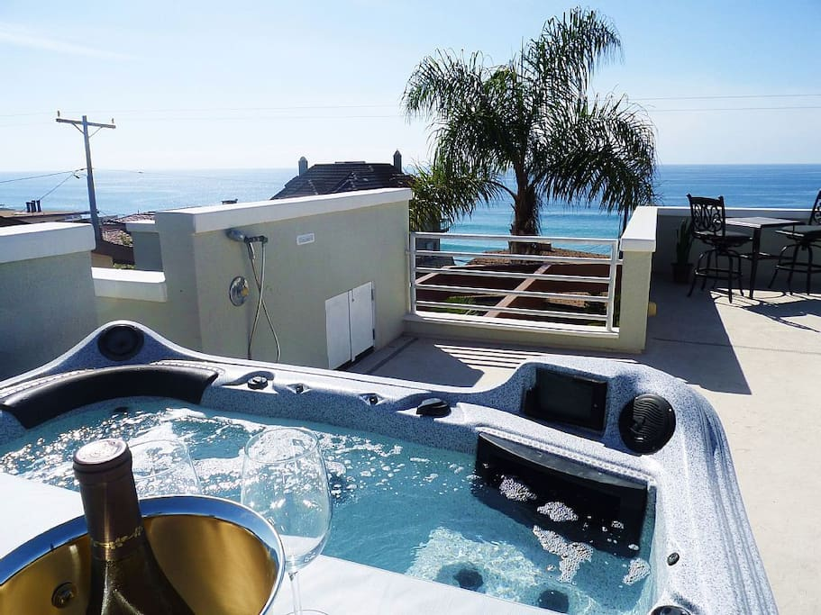 Rooftop Jacuzzi, large private patio for sunning, relaxing, enjoying!