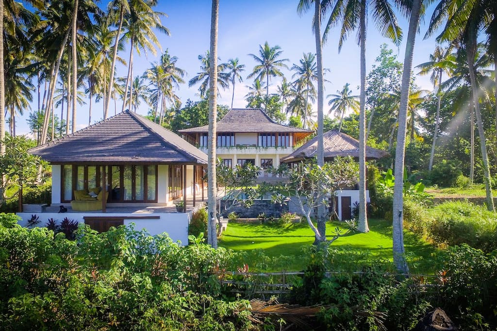 Villa is located at the beach and surrounded by lush nature