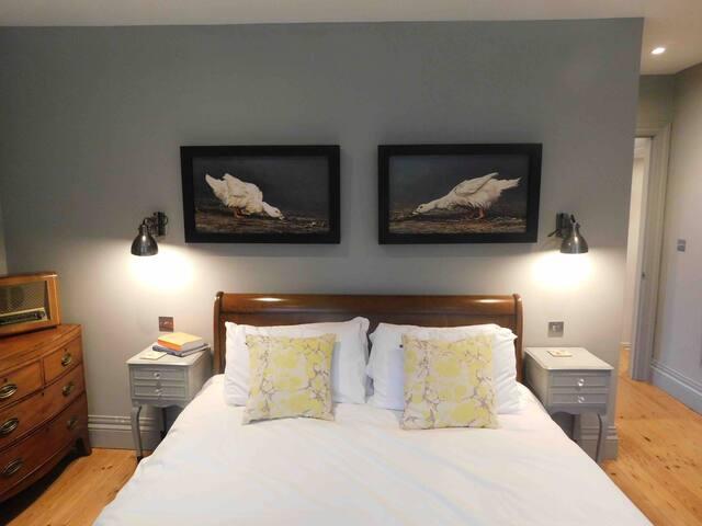 master bedroom superking bed and original artwork