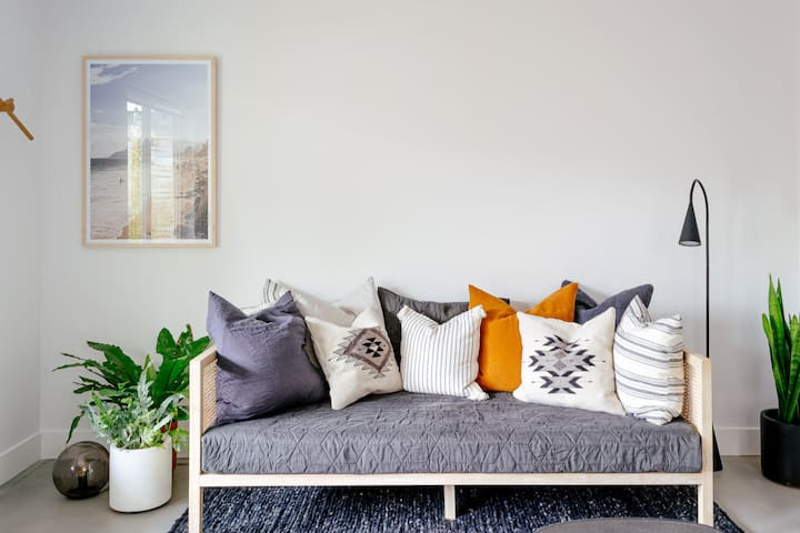 Snuggle up in this comfy sofa bed adorned with linens and pillows collected from around the world.