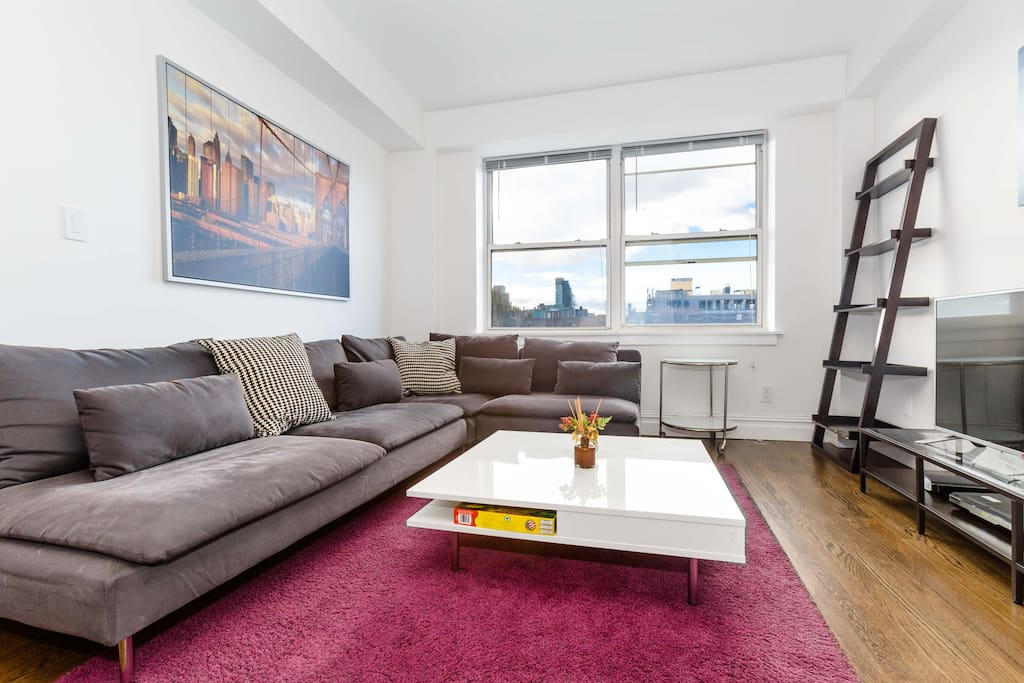 Sprawl out on our oversized plush sofa after a long day exploring the city