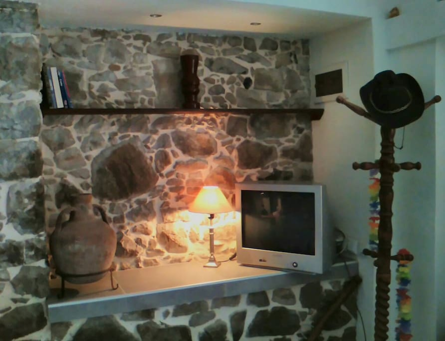 Originally the feeding manger for the animals, now tastefully converted into the Bookshelf, TV area