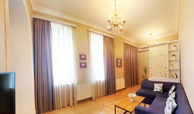 « Living Room » Bright, cozy room with the balcony.  There are the central heating and Air-Conditioning systems in the whole apartment. Safety amenities. Free Wifi. Cable TV etc.  ♛♔ ROYAL DISTRICT APARTMENT♔♛