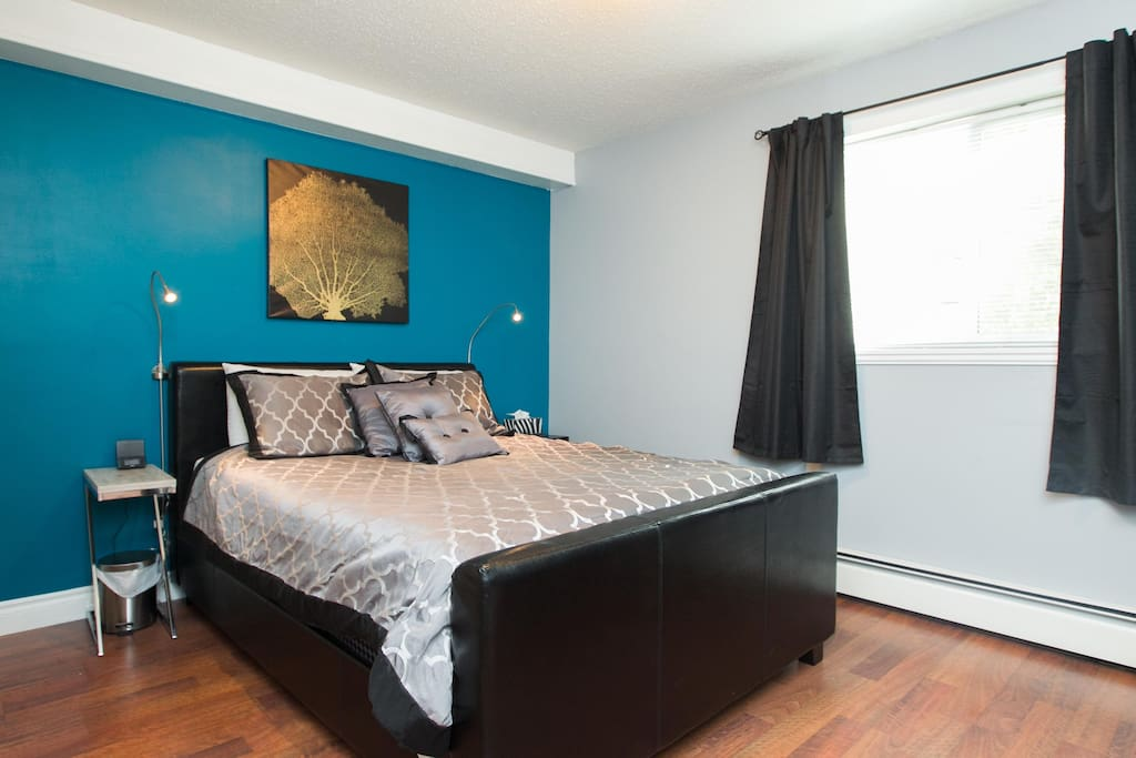 Master bedroom with modern finishings and Euro top queen bed