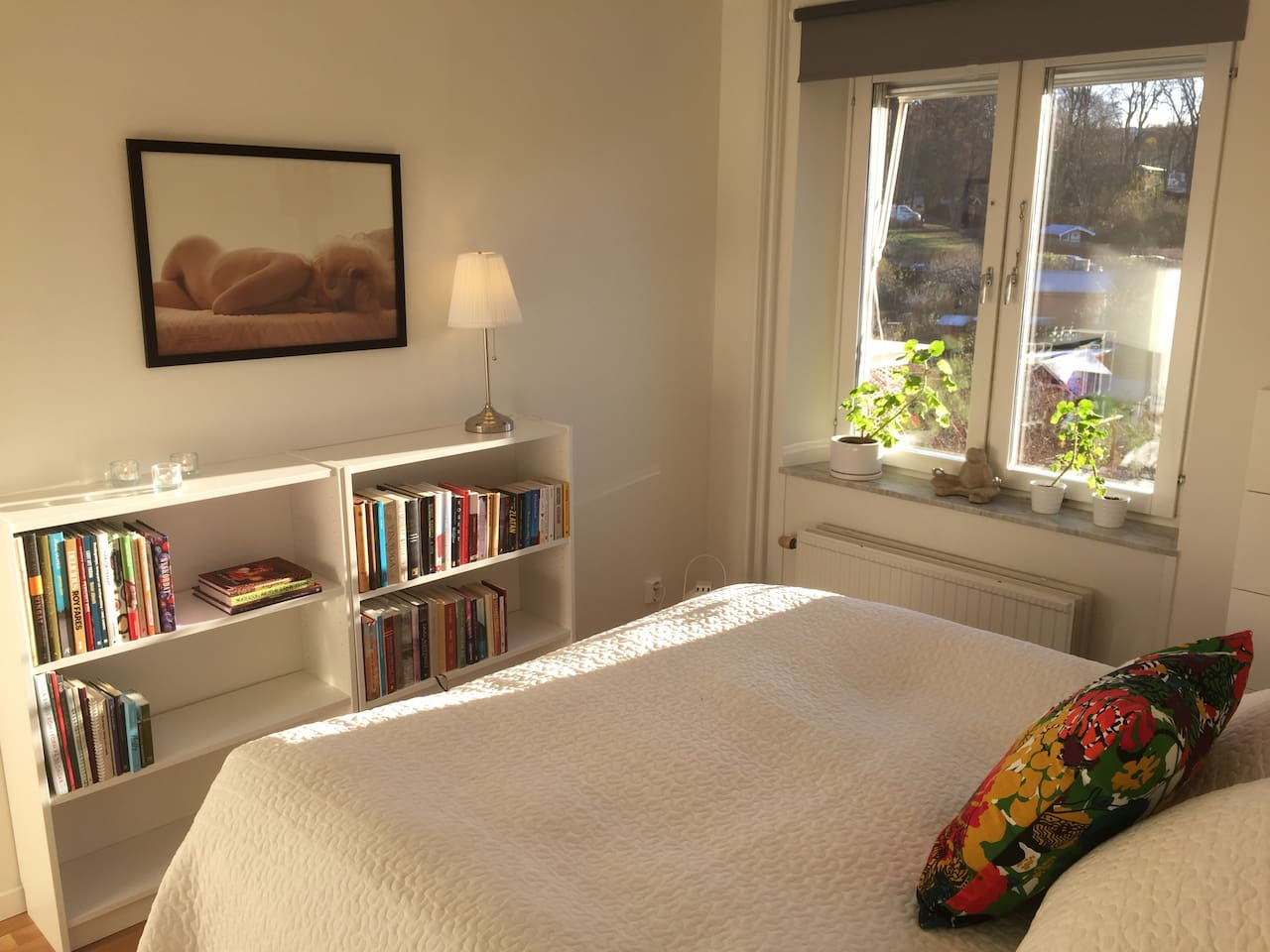 Master bedroom with 160 cm big bed with view over the gardens