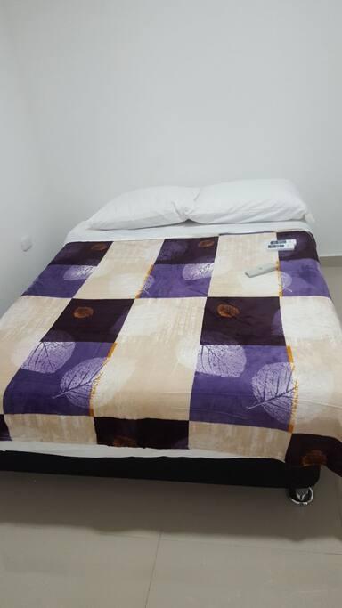 cama habitación 1