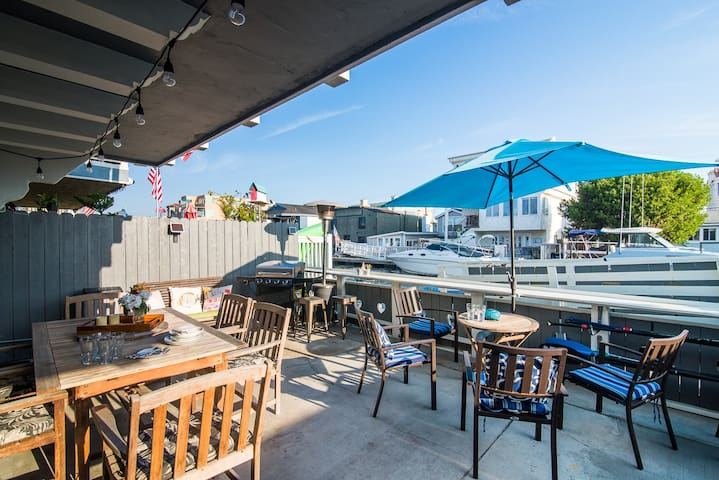 Large patio with lots of seating, heating and BBQ overlooking canal.