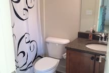 Guests room bathroom with tub shower.