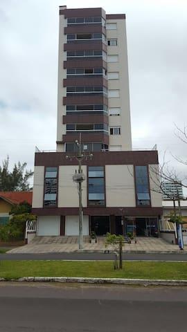 Apartamento com vista para praia - Tramandaí - Byt