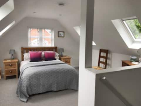 Spacious, light, airy bedroom with ensuite and dressing area