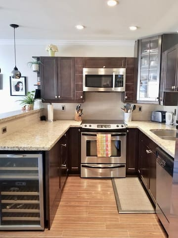 Large kitchen with toaster and coffee pot
