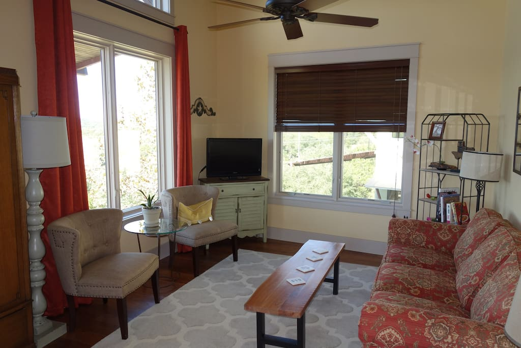 Spacious relaxing living room with lots of natural light and expansive views of the Hill Country.