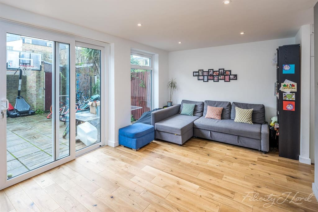 Spacious living room with comfy sofa that can turn into a large double bed.