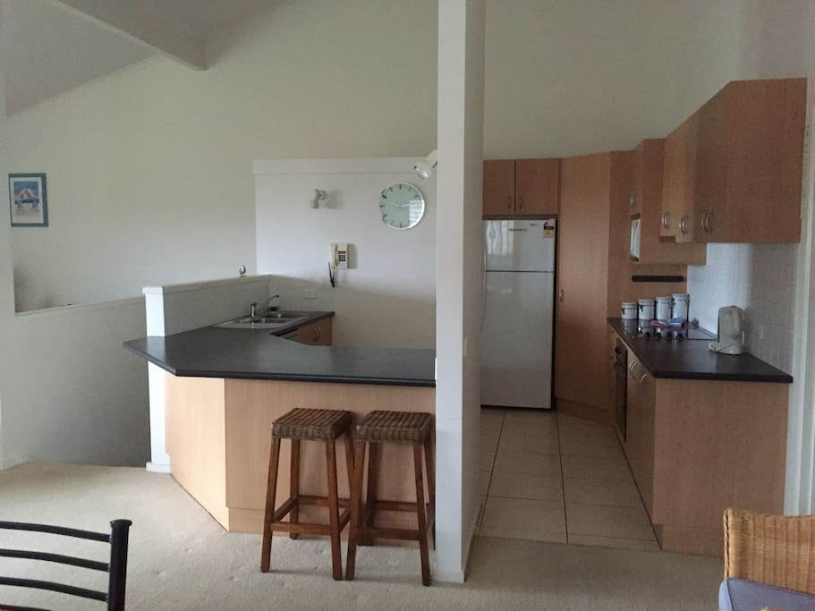 Well appointed kitchen which includes dishwasher.