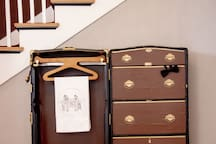 This 1920 vintage suitcase is just one of the many decor items in this home that seamlessly transports you back in time.