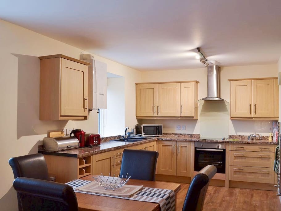 Full kitchen as part of open plan diner and living room