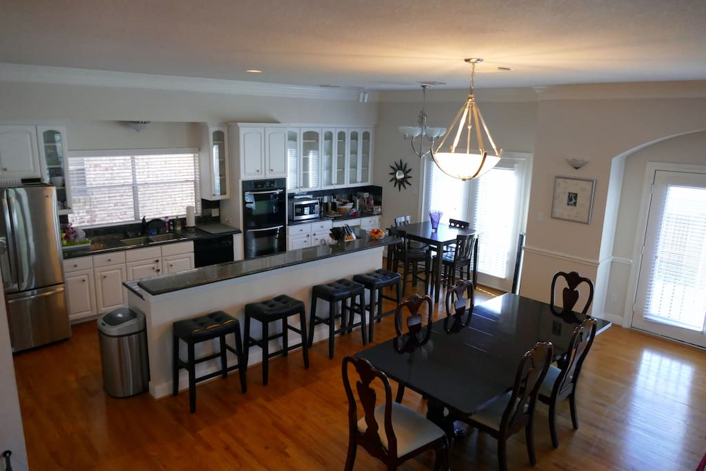 Chef's kitchen with glass inlays, granite countertops and upgraded appliances