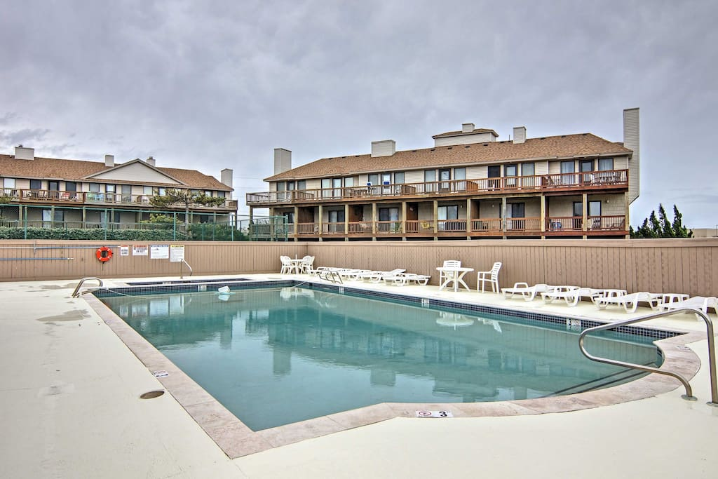 Start your vacation mornings with a dip in the community pool and hot tub at the Sea Dunes community!