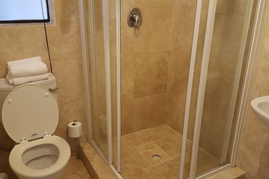 Bathroom - shower, toilet, basin