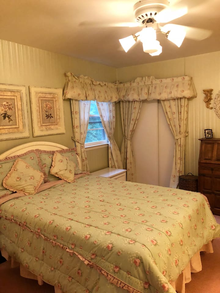 Very comfortable room with overhead fan for added comfort. The room has a comfortable chair with a reading lamp. Double closet   Dresser, night stand with drawers and a desk for your Convenience