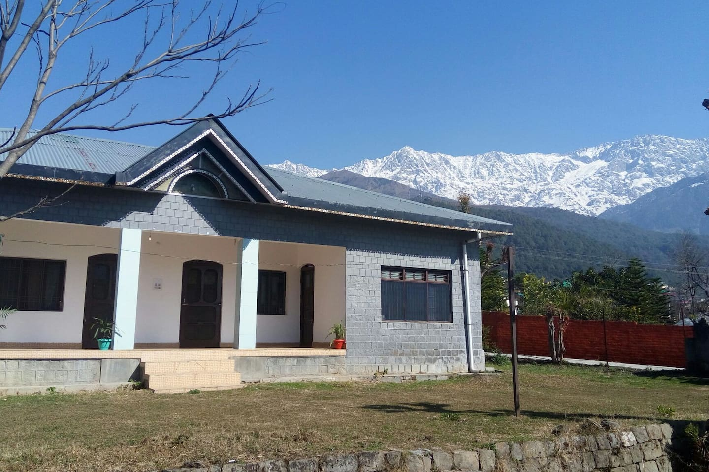 Front view of the house with Dhauladhar range's in the back