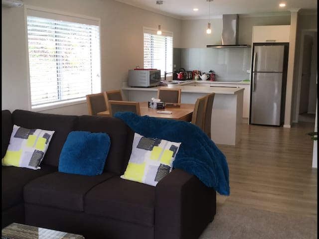 Spacious lounge with double glazing, heat pump & aircon. Relax with:  - Sky TV - Board games - A great selection of magazines - Children's toy box  - Children's books