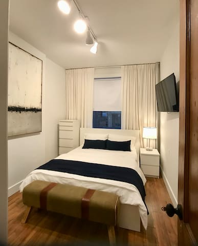 BEDROOM WITH QUEEN BED AND SMART TV