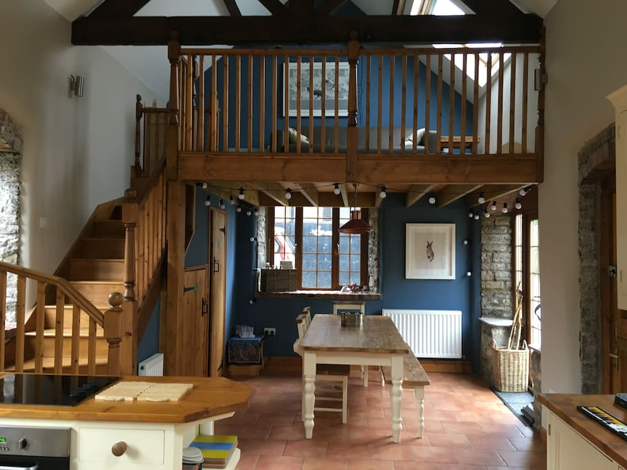 Kitchen-Dining room with Mezzanine above.