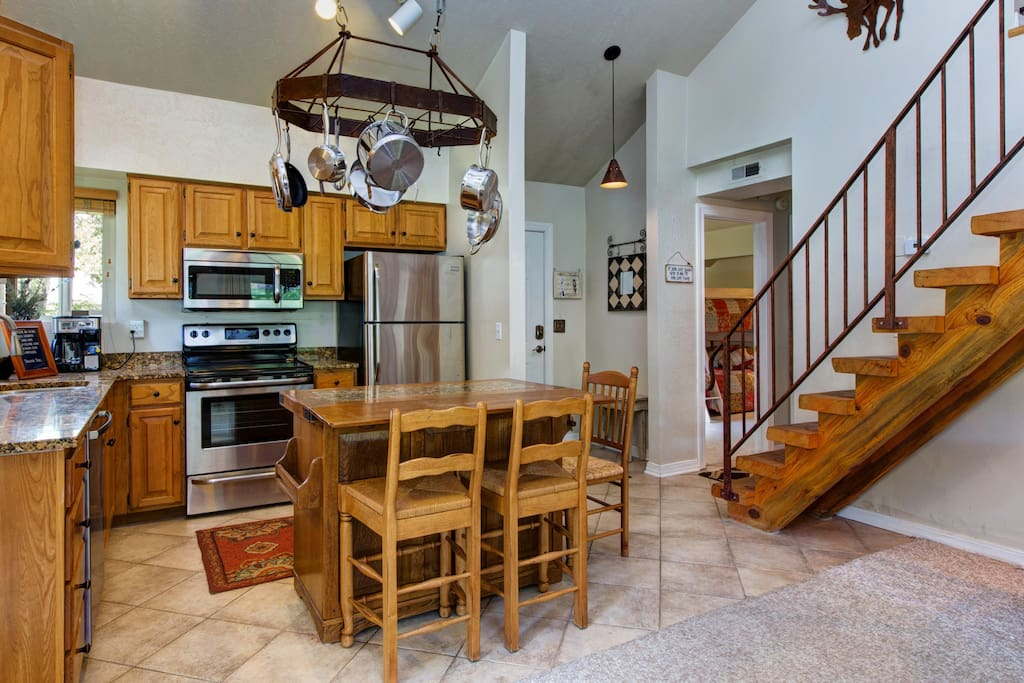 Seating for 3 around the island and stainless appliances