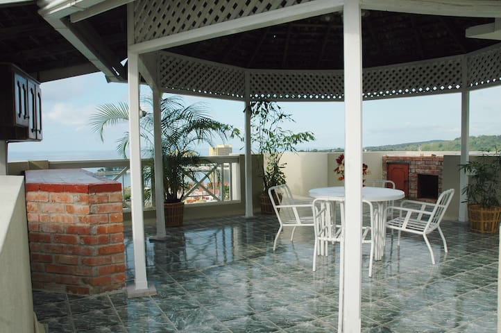 Rooftop balcony features outdoor barbeque grill