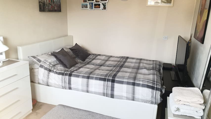 Comfortable Double Bedroom with Large TV and Sky q