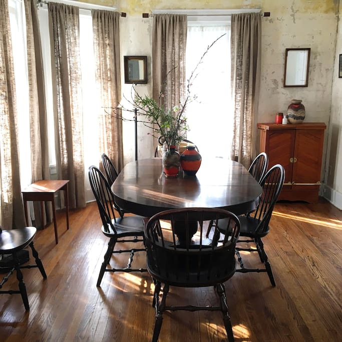 Formal dining room with extra leaves and chairs.