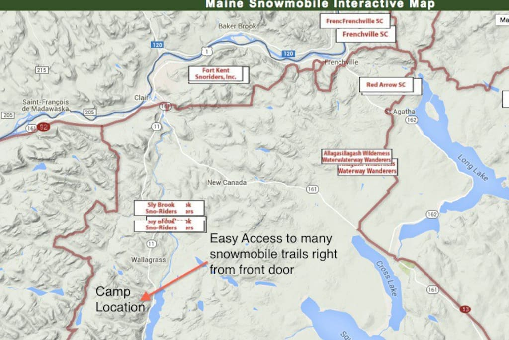 Numerous snowmobile trails heading from front door of lake-house