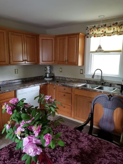 Long countertops, lots of cupboard space,  many conveniences, bakeware, cookware, and dishwasher. Kitchen Aid mixer, recent updates throughout.