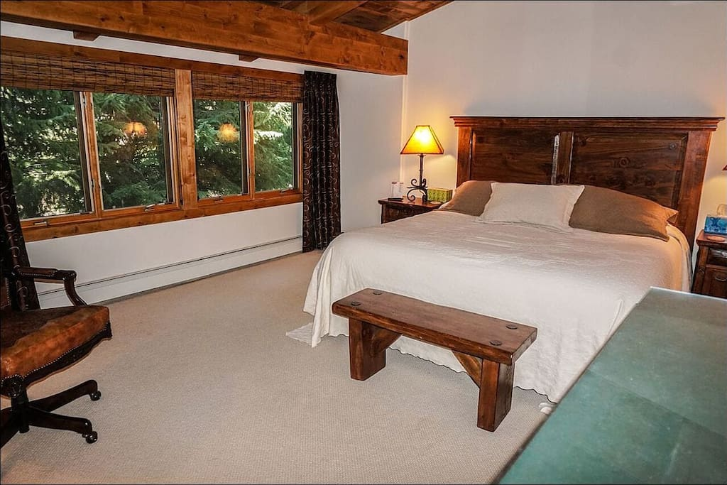 Master Bedroom Boasts a King Bed, Vaulted Ceilings, and Private Bath