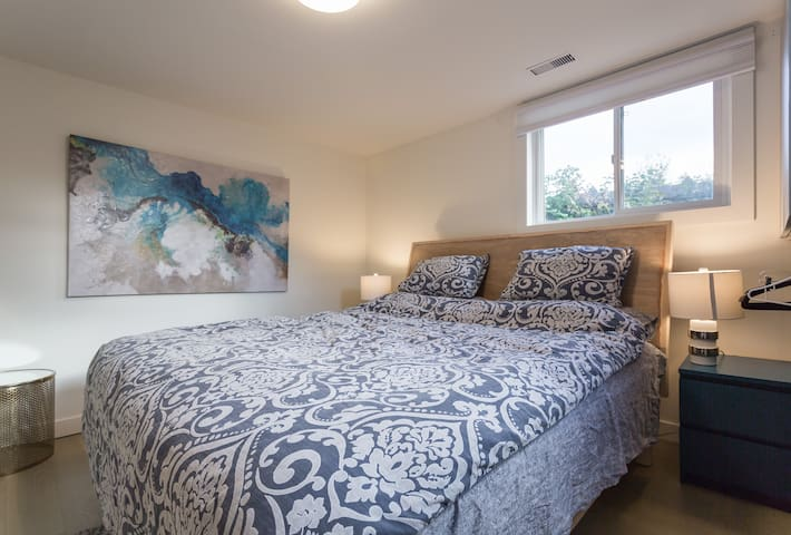 There's a king-size bed in one of the bedrooms (pictured here). The other rooms have a queen-size bed, two single beds and a single bed.