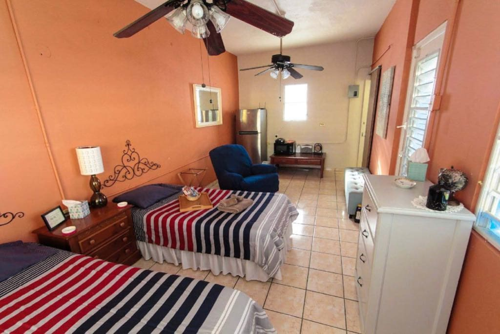 Two twin beds with private entrance. for you to rest after a day at the beach.