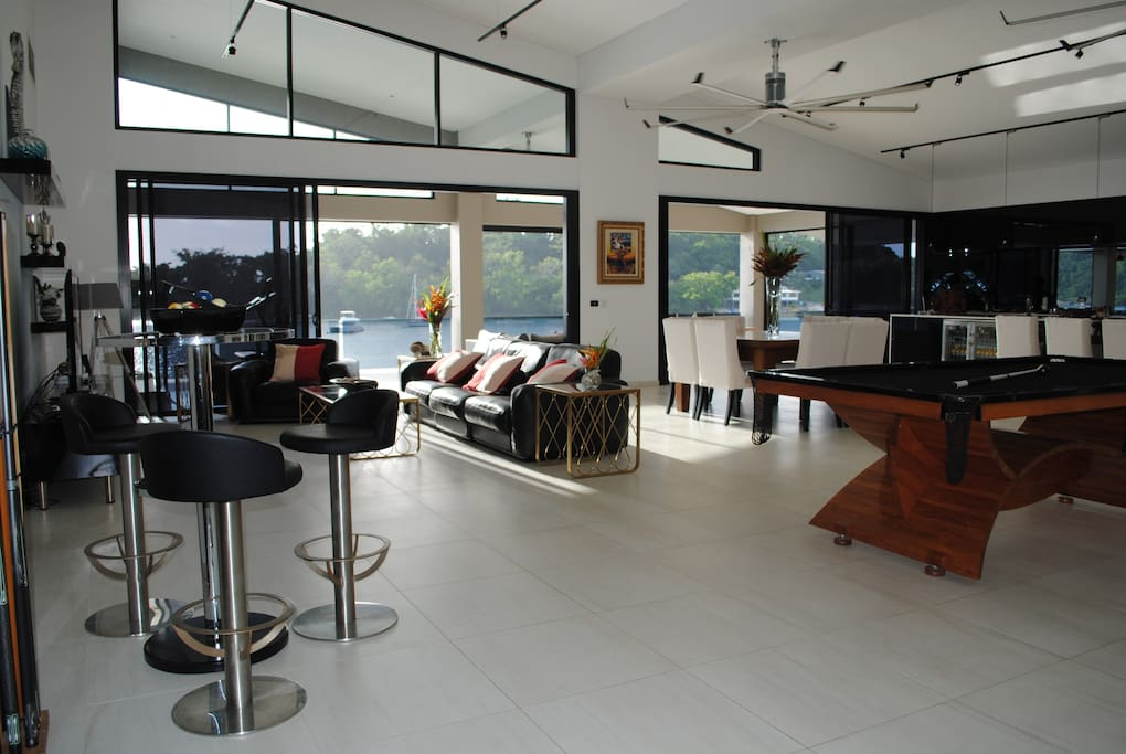 Onyx Vanuatu Harbour Resort Residence Pandanus Penthouse - Open floor plan with dining, kitchen, living & entertaining areas opening onto veranda overlooking Port Vila Harbour