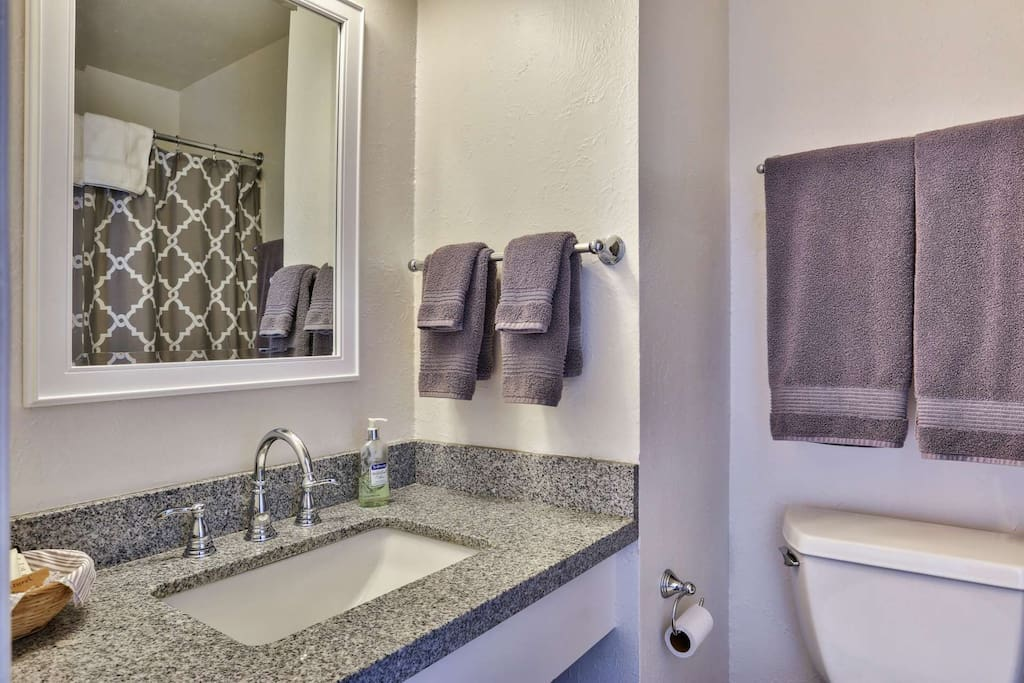 Bathroom with bath and shower combo (picture may not depict the exact bathroom for your stay)