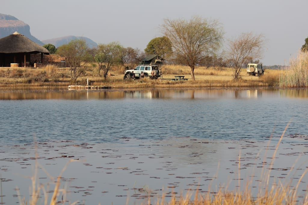 The Bush Camp Site overlooks the large dam with the Waterberg Mountains in the backdrop.