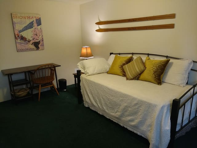 Second Bedroom with a very comfortable twin daybed plus trundle and has a work space that includes desk.