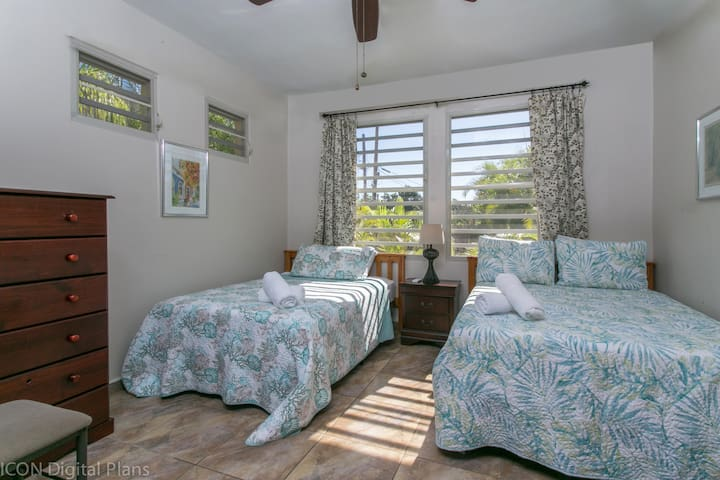 3rd Bedroom has 2 twin beds and 1 full bed, small sitting table & refrigerator.