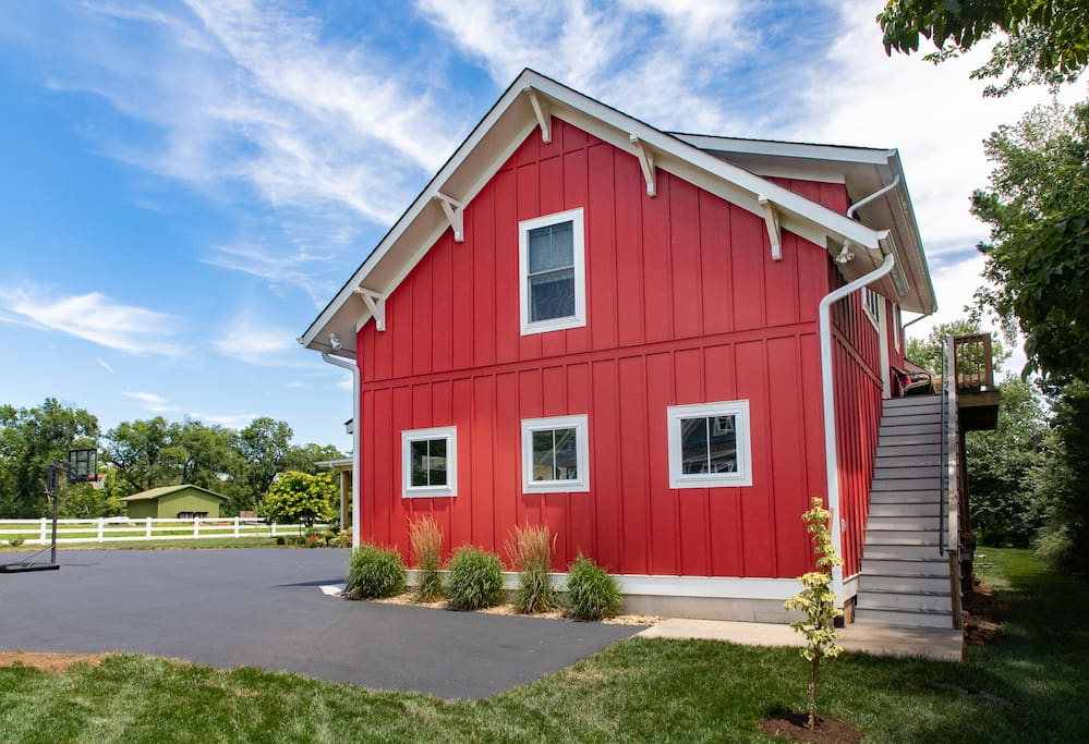 There is a designated parking area and exterior private staircase/entrance to the barn.