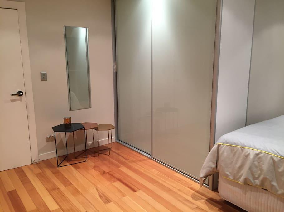 Spacious bedroom w a built in wardrobe