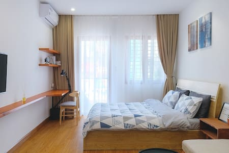 Retreat to a Sunlit Studio w/ balcony downtown SGN
