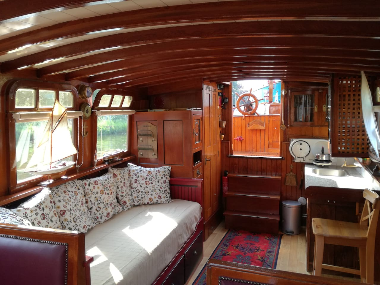 """Enjoy an overnight stay in a one-of-a-kind, historic boat named """"The Tromp."""" Built in 1938, The Tromp offers the old world, romantic charm of living on the water in the midst of history (www.salonbootdenhaag.nl)"""